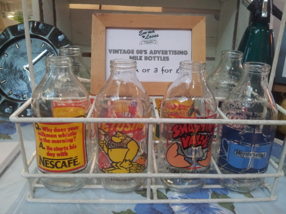 Vintage advertising milk bottles at the Hackney Flea